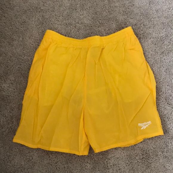 1ceef5648451a Yellow Reebok swim trunks. M_5ade66803a112ed0b3b11821